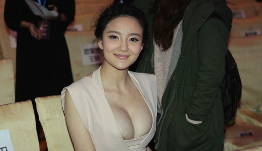 Liuyuxin siting smiling with clothes open