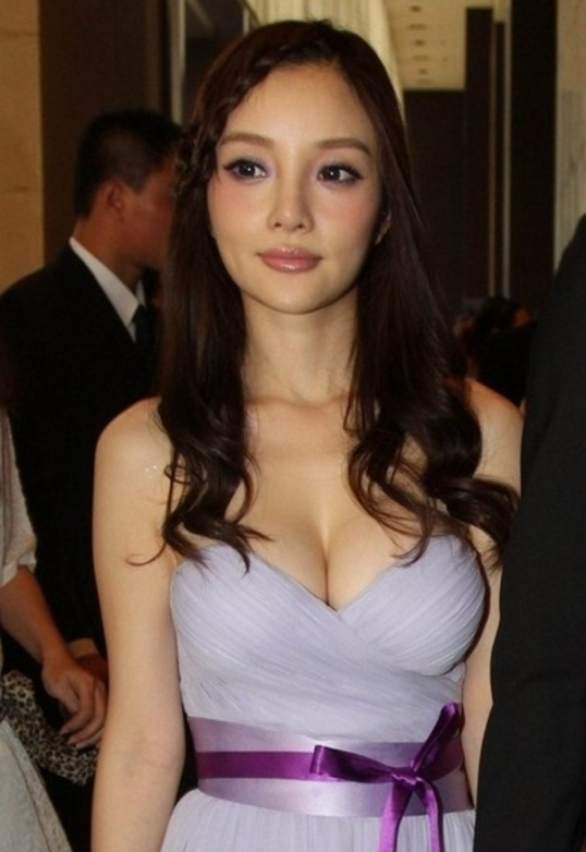 Lixiaolu in purple long dress showing big boobs